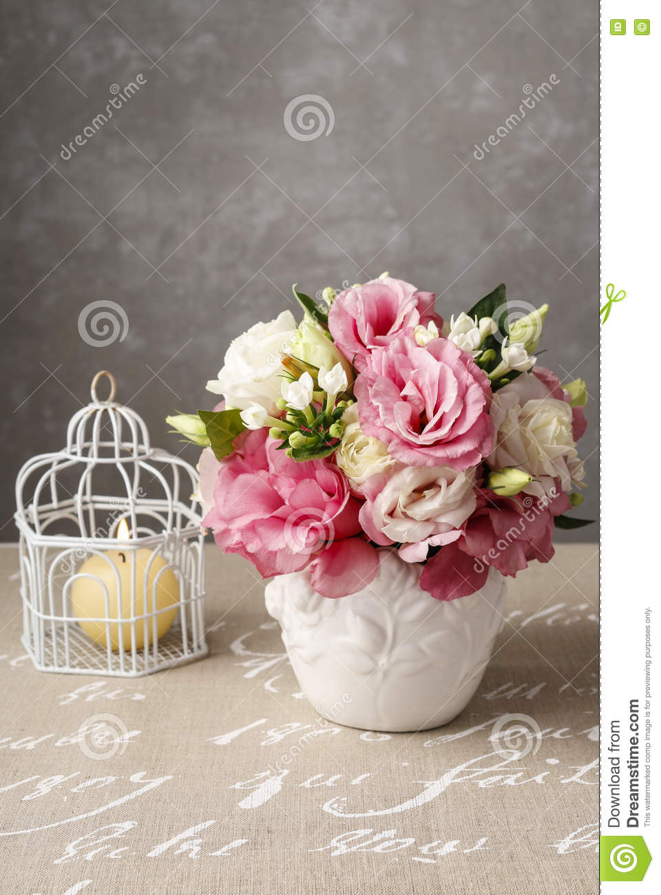 Bouquet Of Pink Eustoma Flowers And Scented Candle Stock Photo