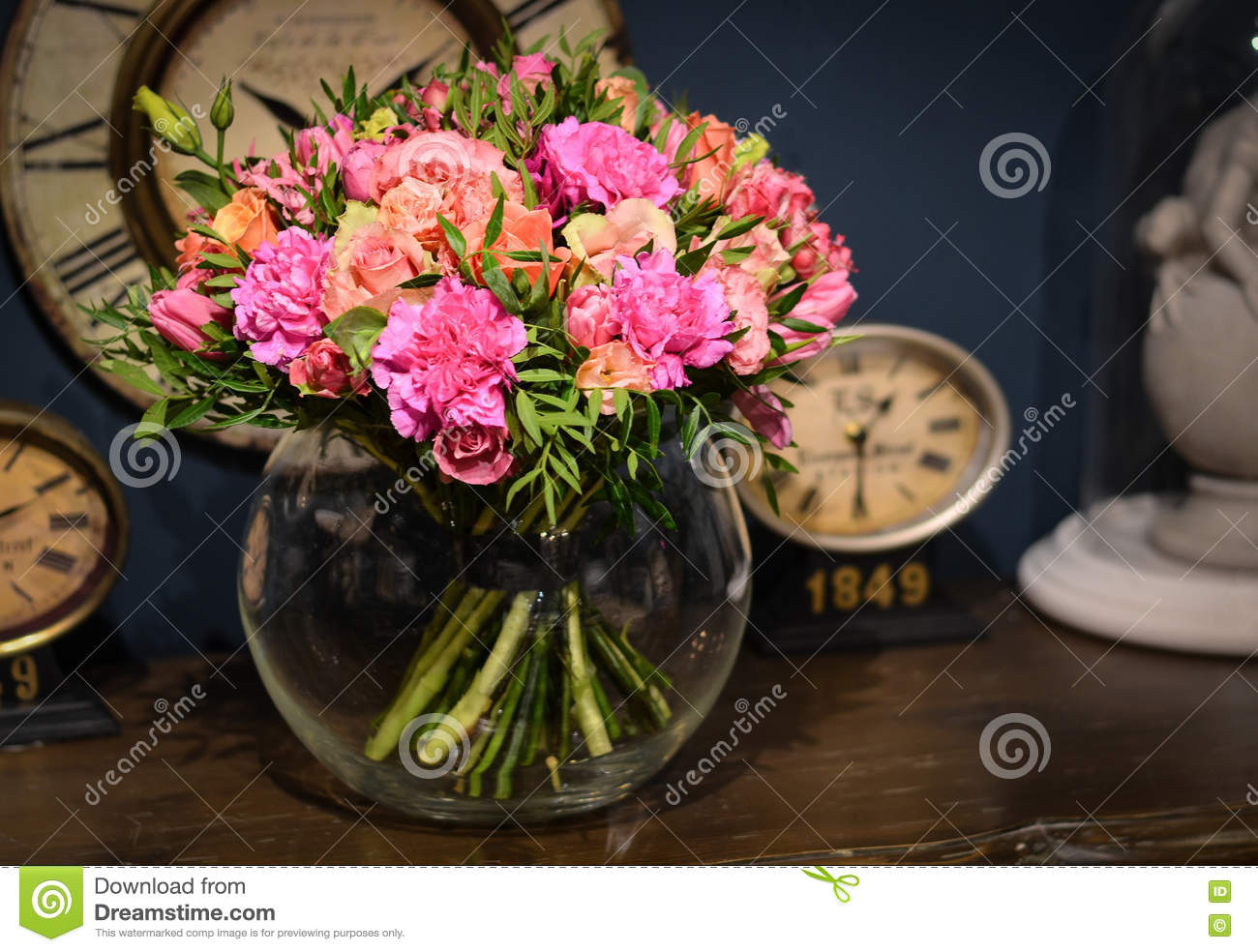 Bouquet Of Pink Roses On A Blue Background Wall With Vintage Clock on