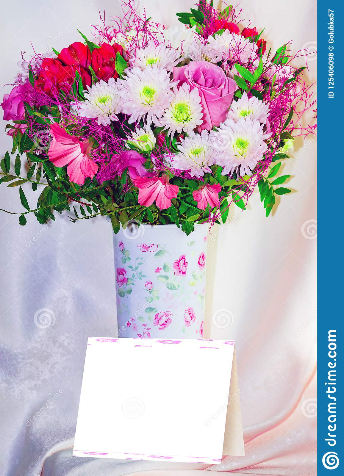 Bouquet Of Pink And White Flowers In A Light Tall Vase On A