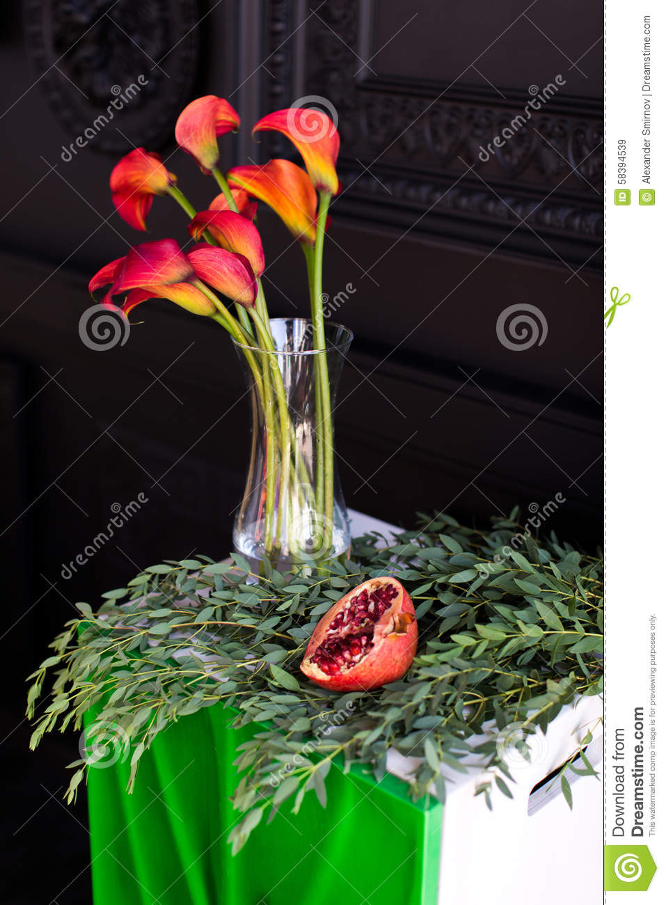 Bouquet of red calla lilies in a glass vase with a pomegranate and royalty free stock photo reviewsmspy
