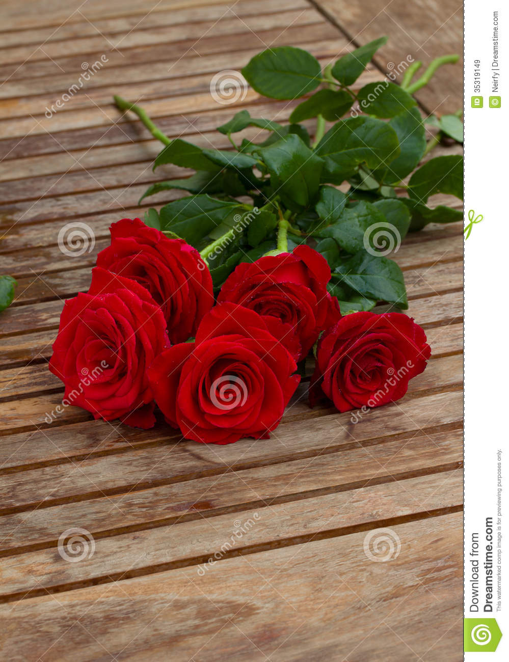 Bouquet of red roses on table stock image image of droplet floral bouquet of red roses on table izmirmasajfo Gallery