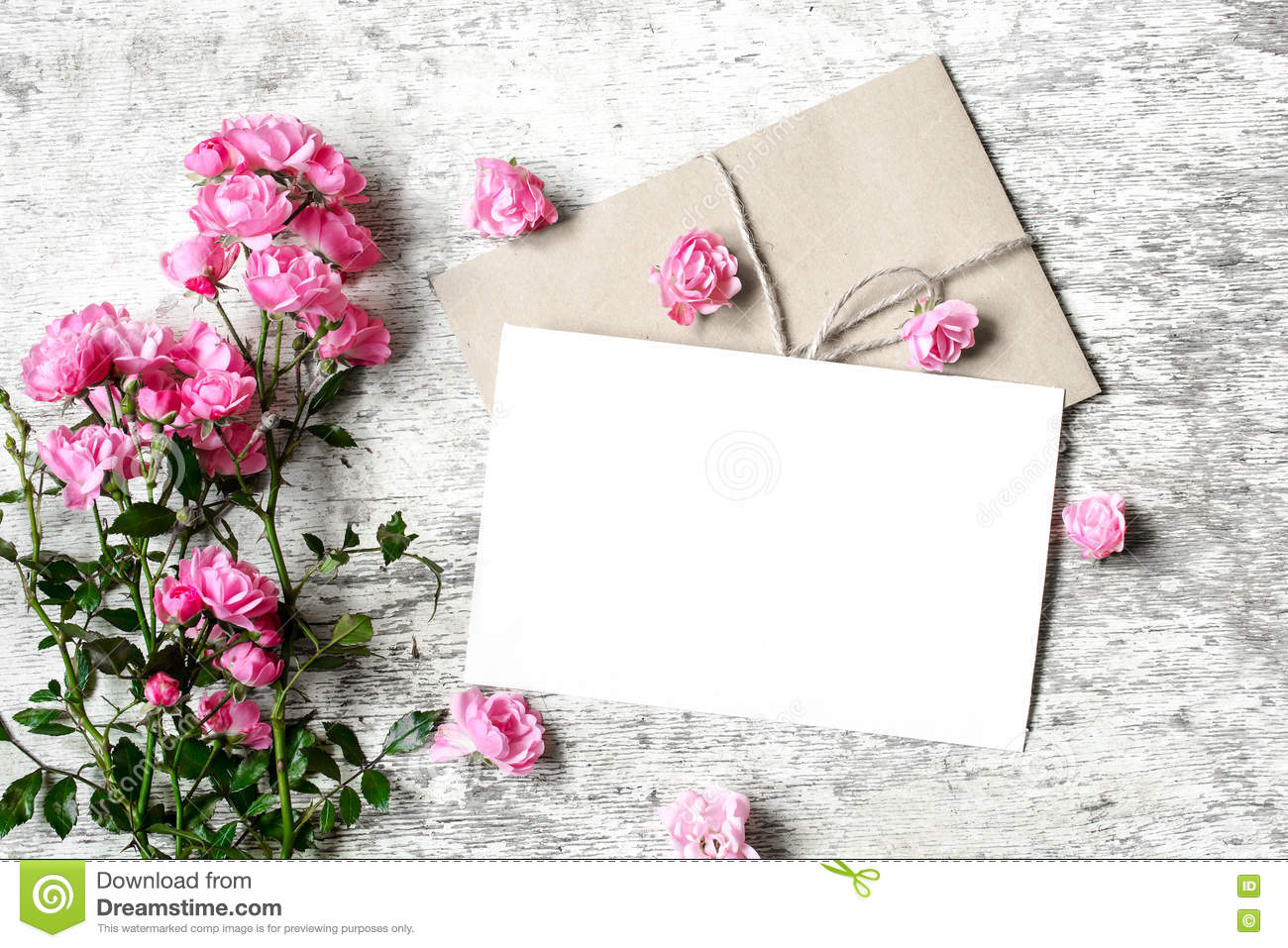 Bouquet Of Roses With A Blank Greeting Card And Envelope Stock Photo