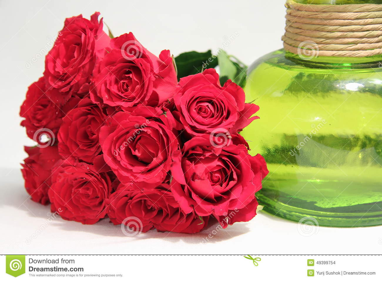 A bouquet of roses and green vase