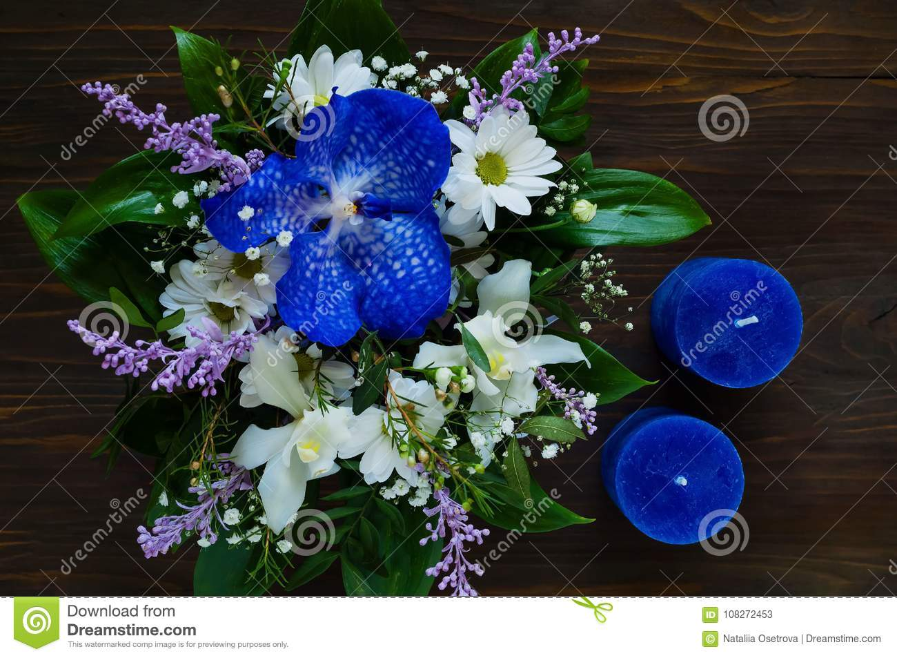 Bouquet Of Spring Flowers And Blue Candles Handmade On A Wooden