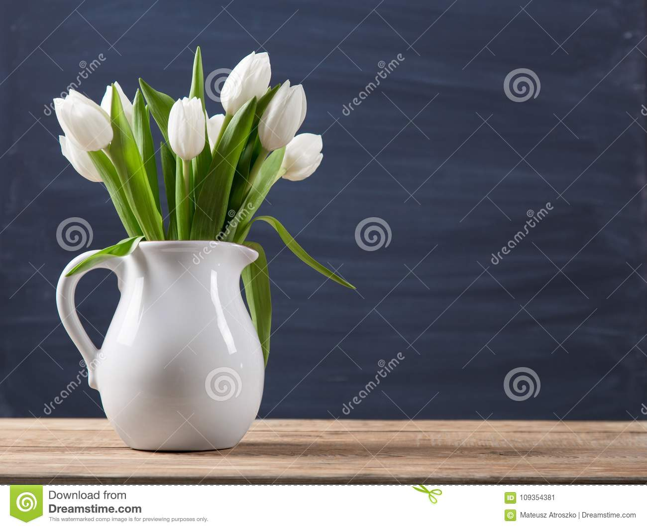 Bouquet Of Tulips In A Oldfashioned Rustic Vase Pot Light Colour