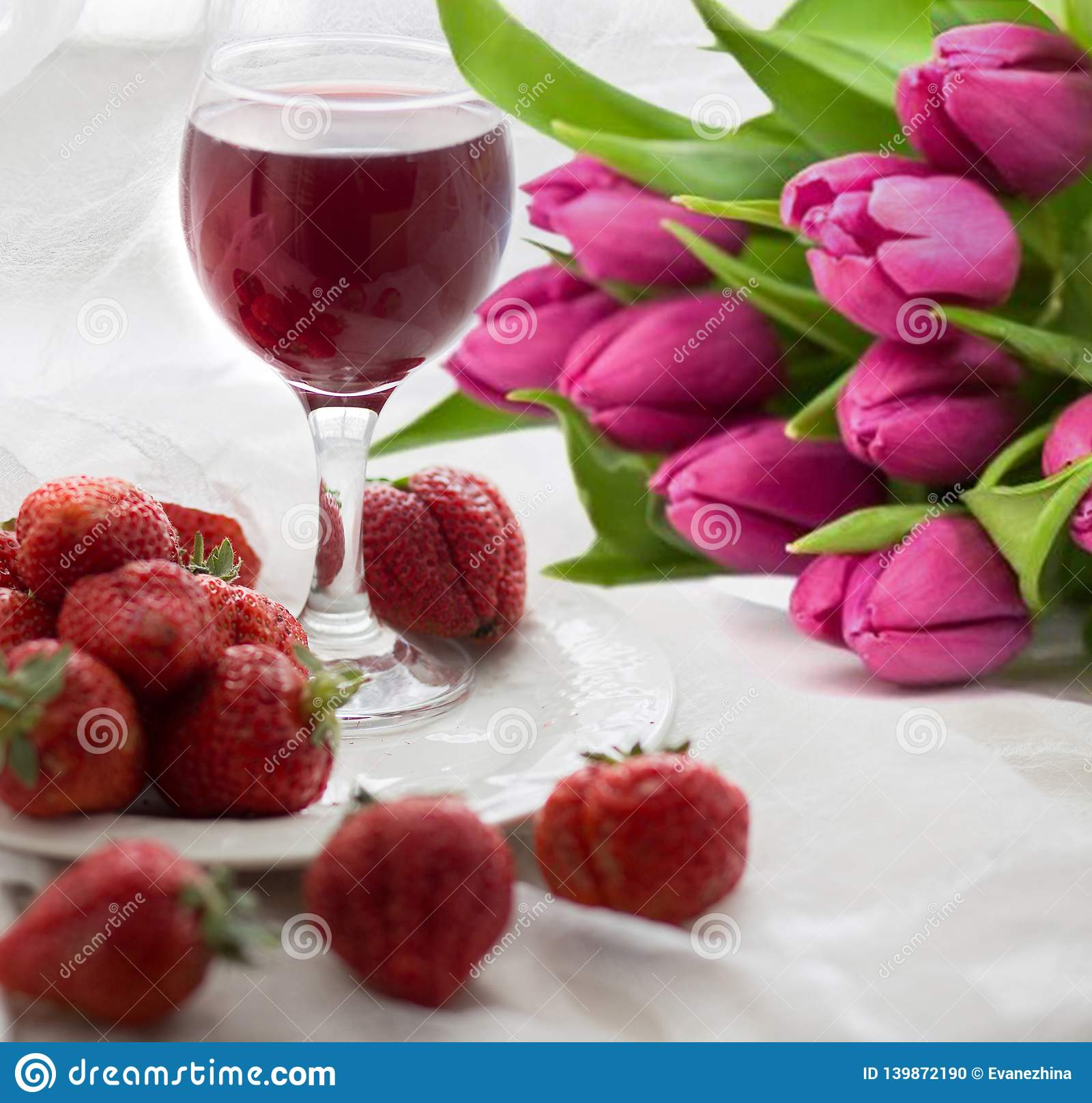 Bouquet of tulips, strawberry and wine