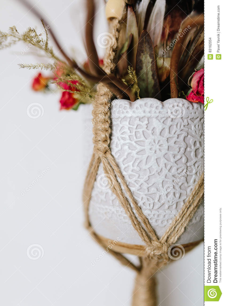 Bouquet in a vase jewelry Knitted macrame terrarium holder . On