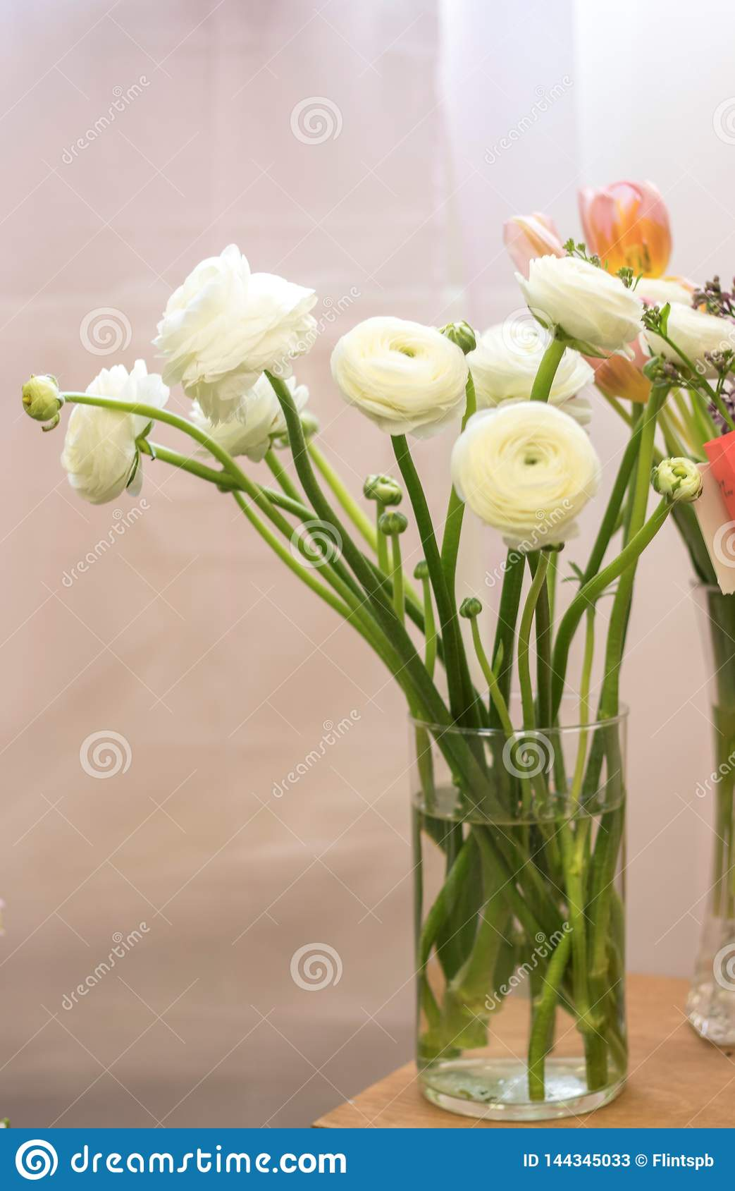 Bouquet in a vase of white buttercups