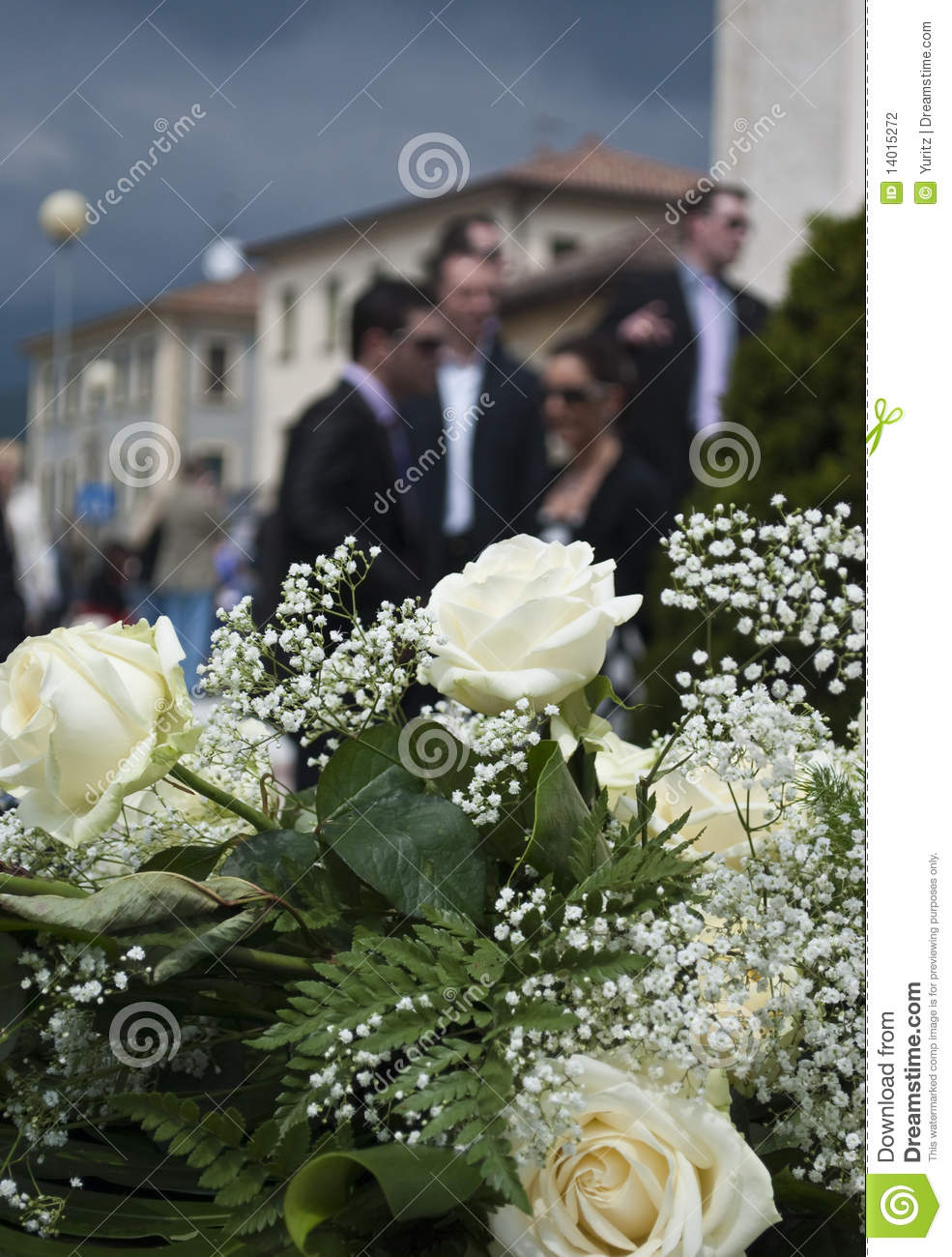 Bouquet and wedding guests