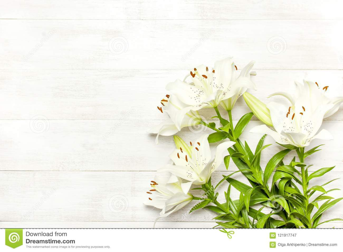 Bouquet Of White Lilies On A White Wooden Background Top View