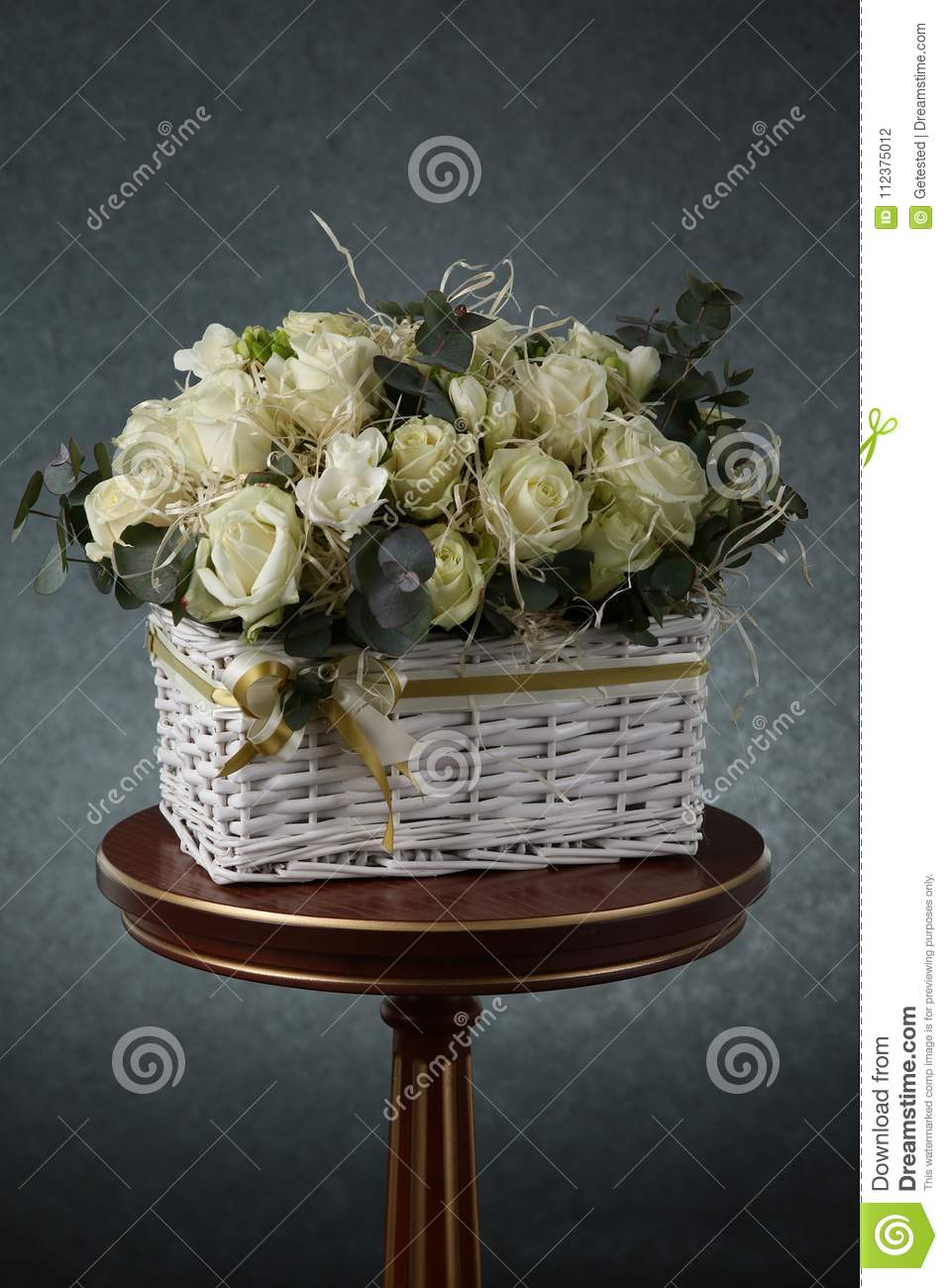 Bouquet with white roses and decorative straw