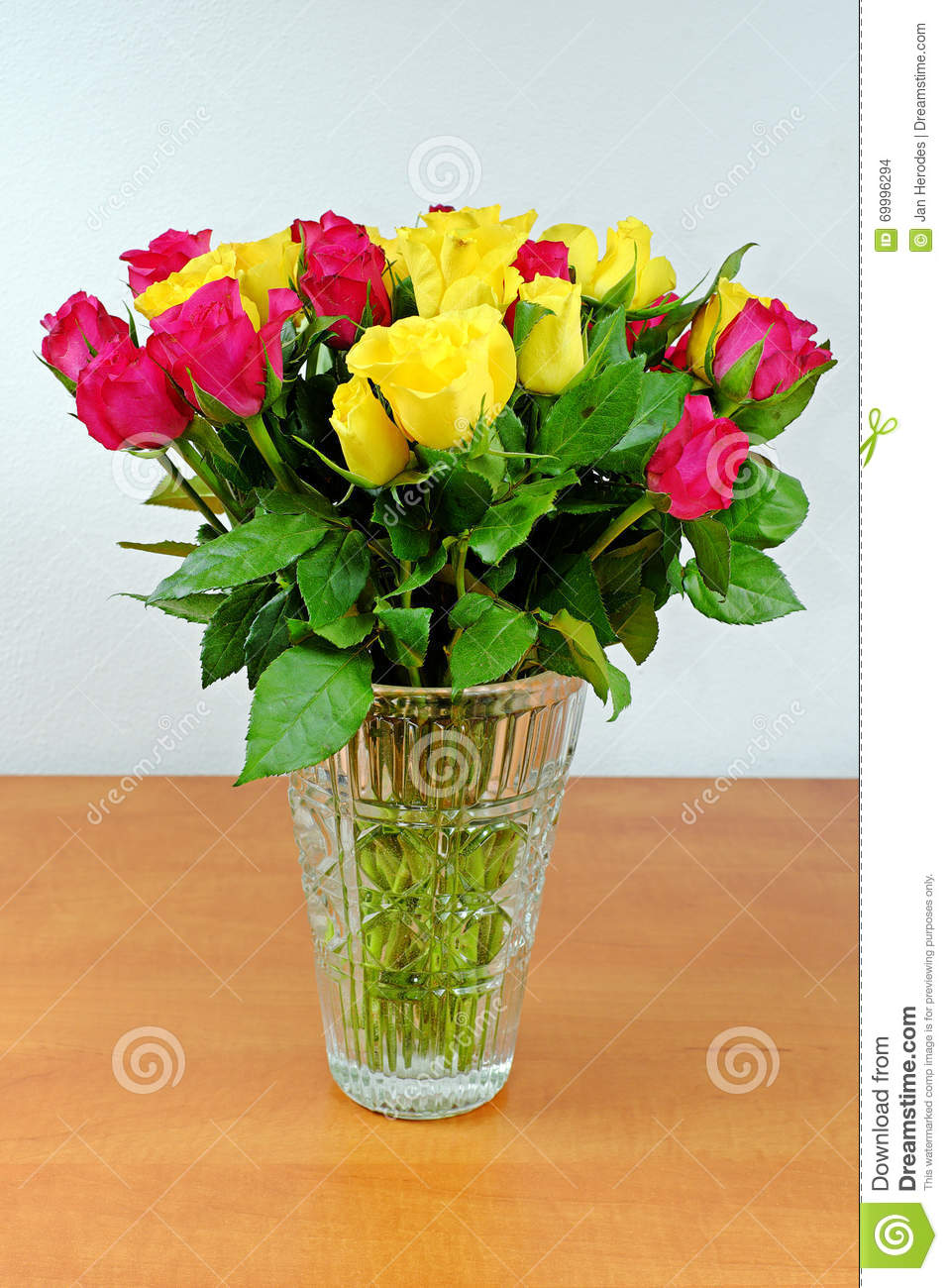 Bouquet Of Yellow And Pink Roses In A Glass Vase Stock Photo Image
