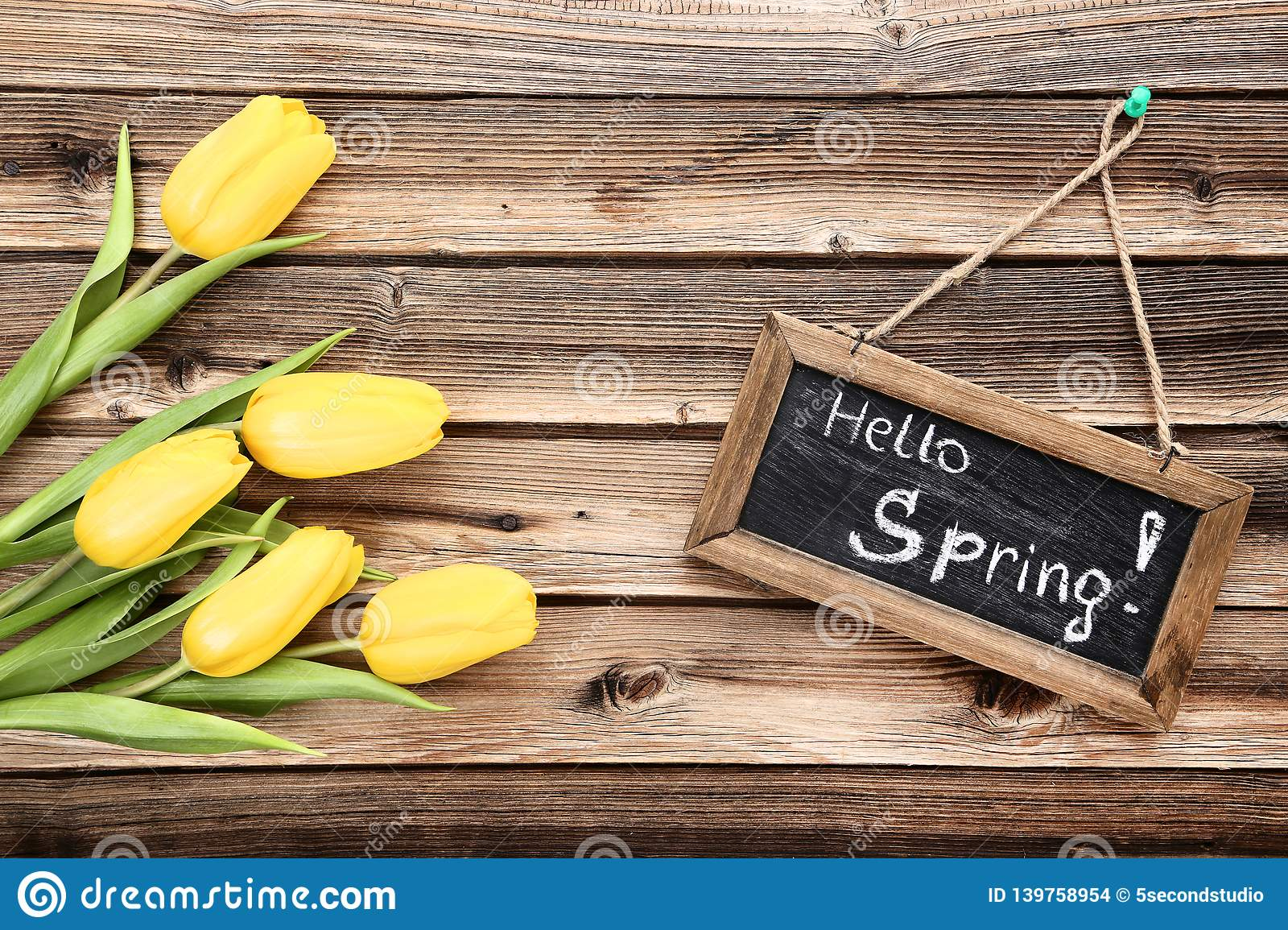 Bouquet of yellow tulips with wooden frame and text Hello Spring stock images