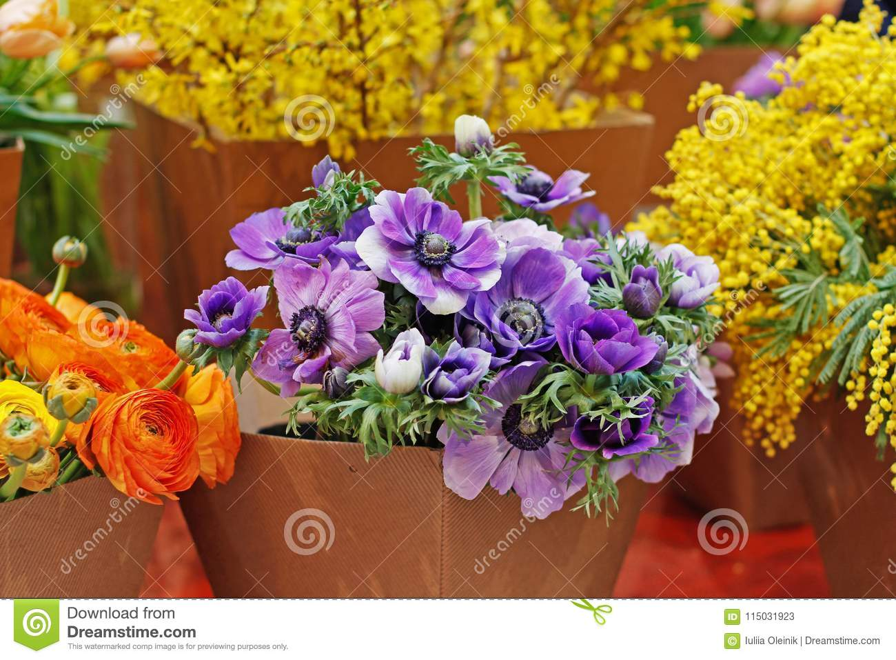 Bouquets Of Beautiful Anemone Ranunculus And Mimosa Flowers In
