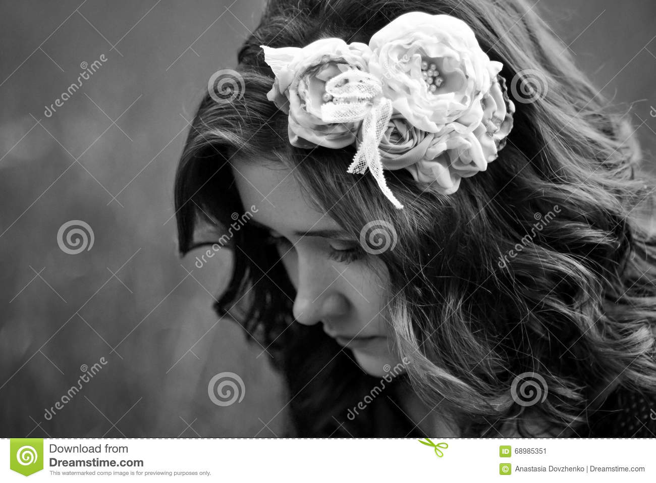 The portrait of sad upset unhappy beautiful attractive cute pretty nice girl with wreath flowers black and white photo beautiful girl think about