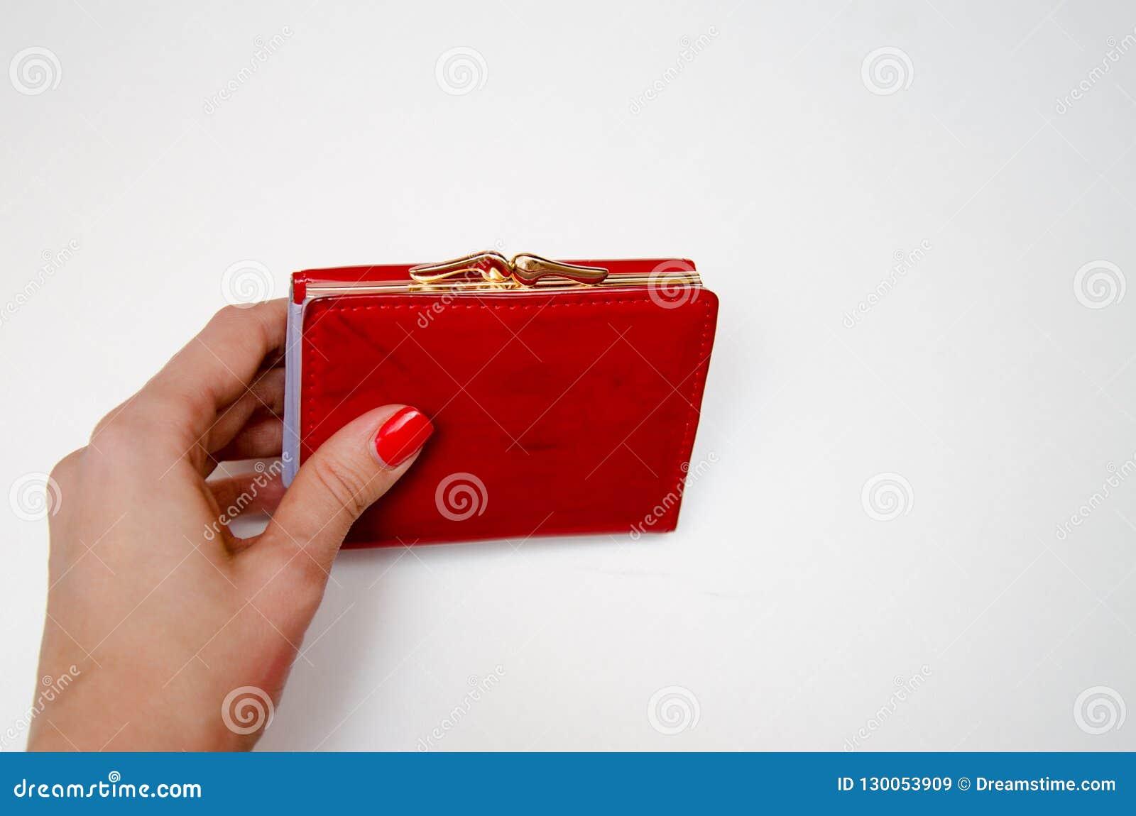 Bourse rouge avec l argent sur un fond blanc