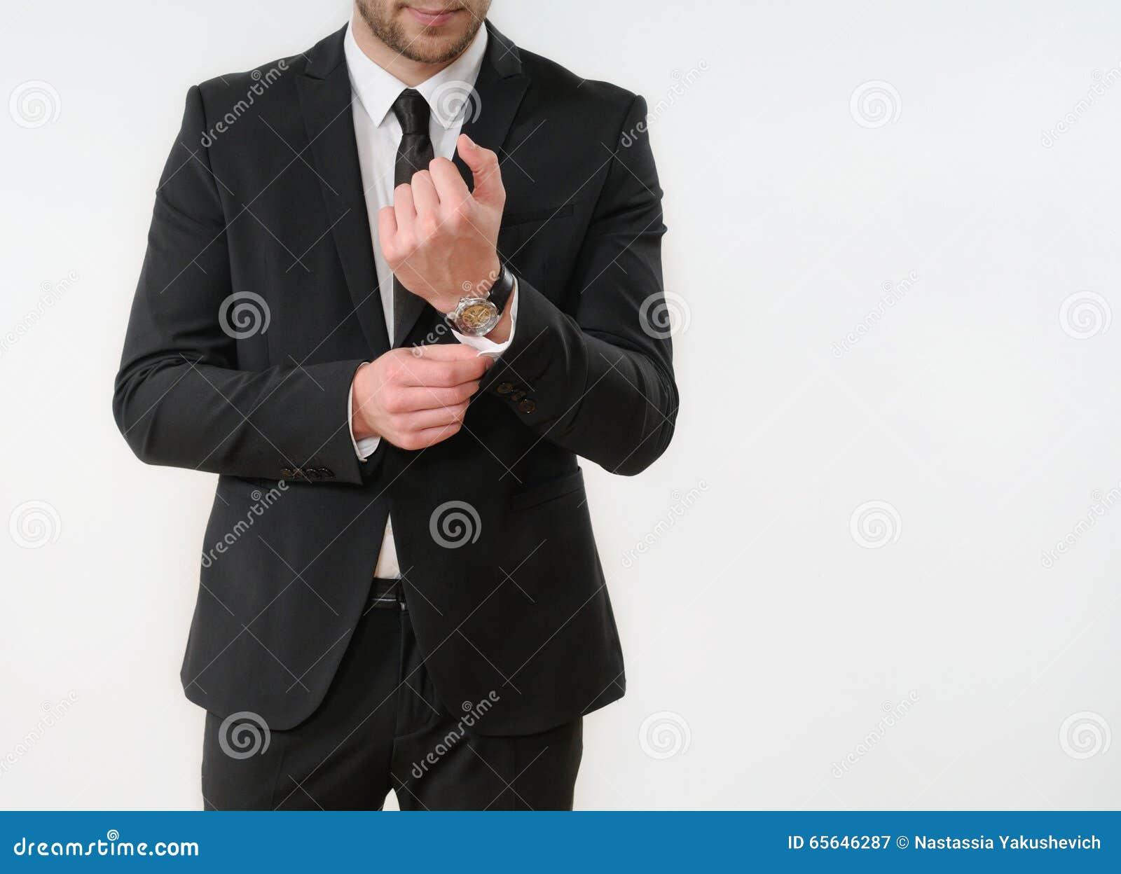 Bouton de côté de corps d homme d affaires vers le haut de son costume noir sur le backgro blanc