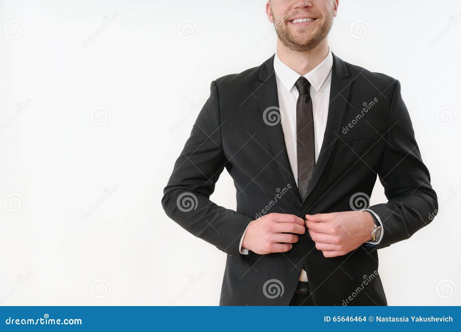 Bouton de sourire de côté de corps d homme d affaires vers le haut de son costume noir sur le blanc