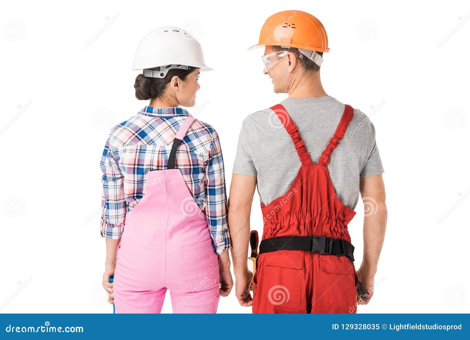 Bouwvakkersteam van de mens en vrouw in helmen