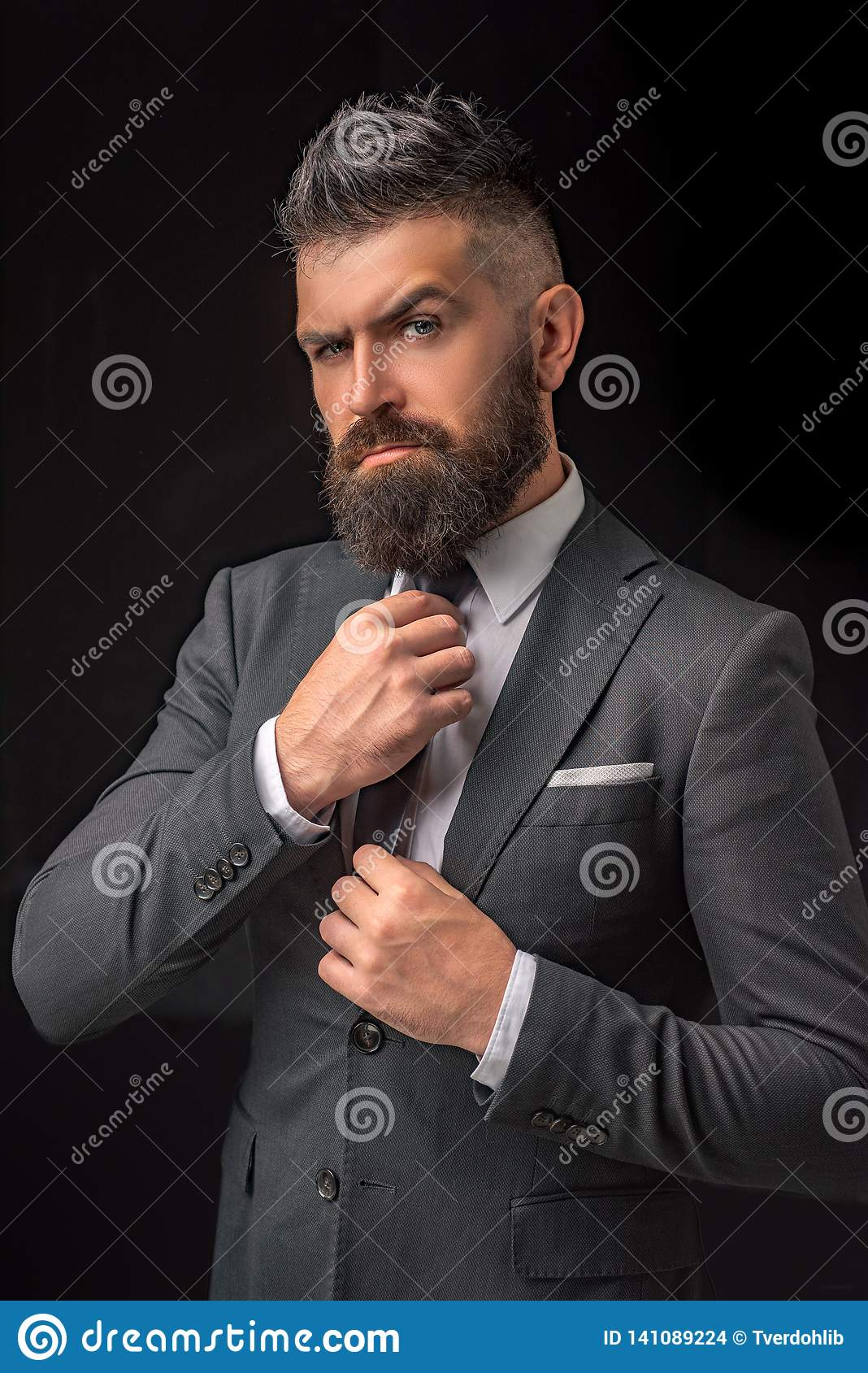 Bow-tie fashion. Bearded man in dark grey suit. Man in classic suit, shirt and tie. Rich man model. Luxury classic suits