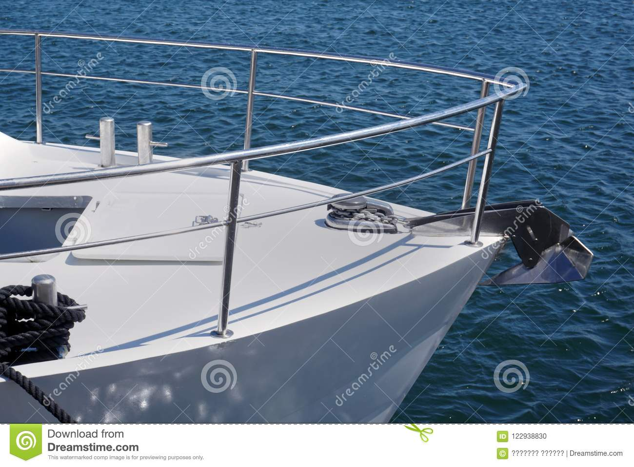Bow Of A White Sailing Yacht Against The Blue Sea With