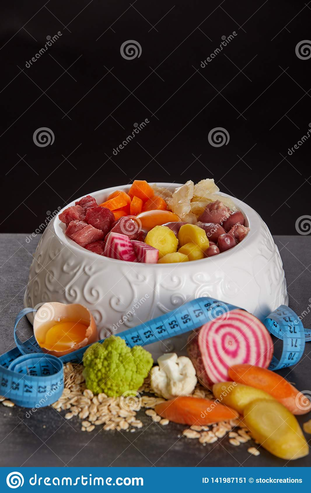 Bowl of barf food mix against black background