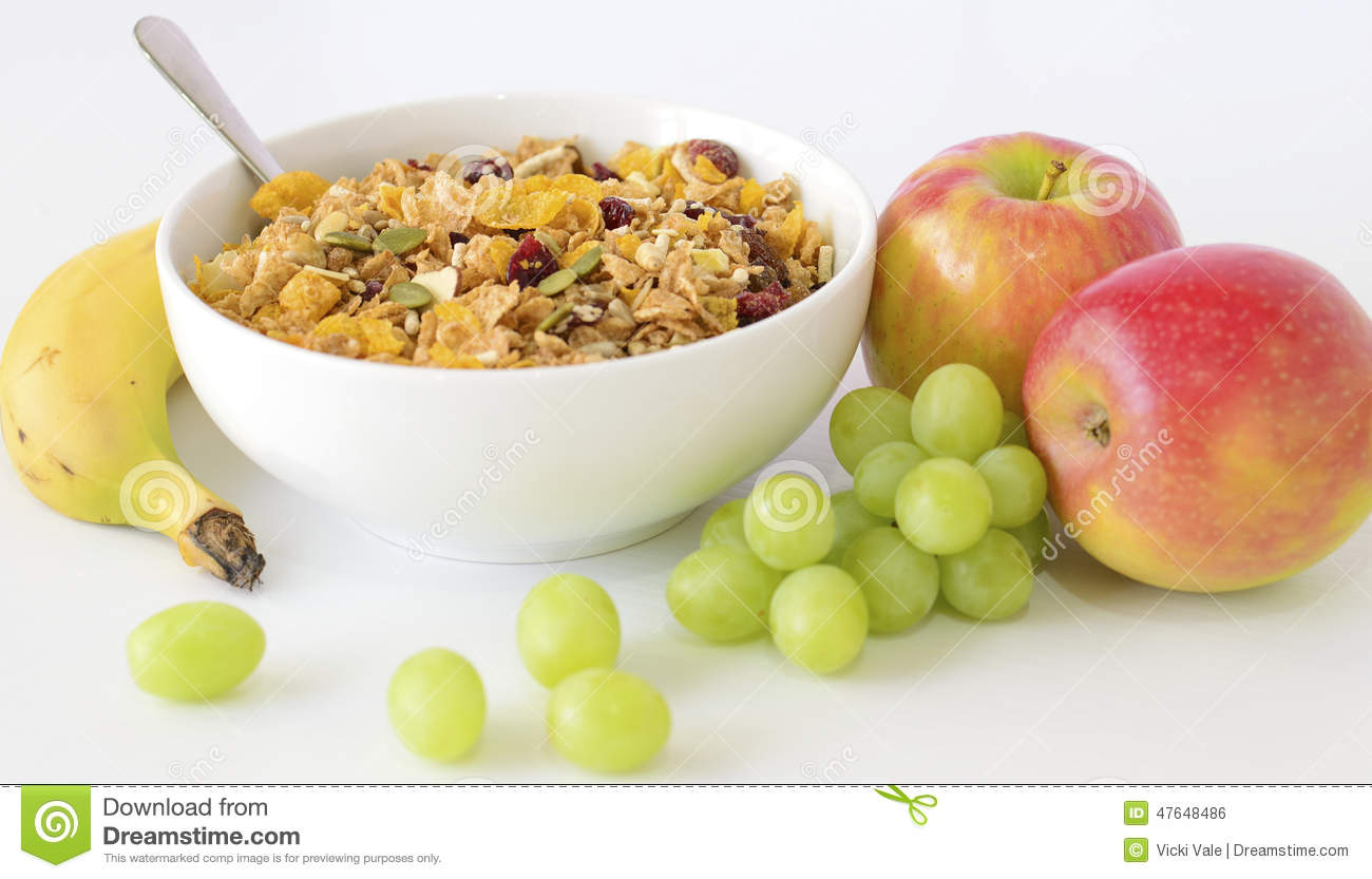 Bowl Of Breakfast Cereal Banana Apples And Grapes Stock Photo Image Of Spoon Food 47648486