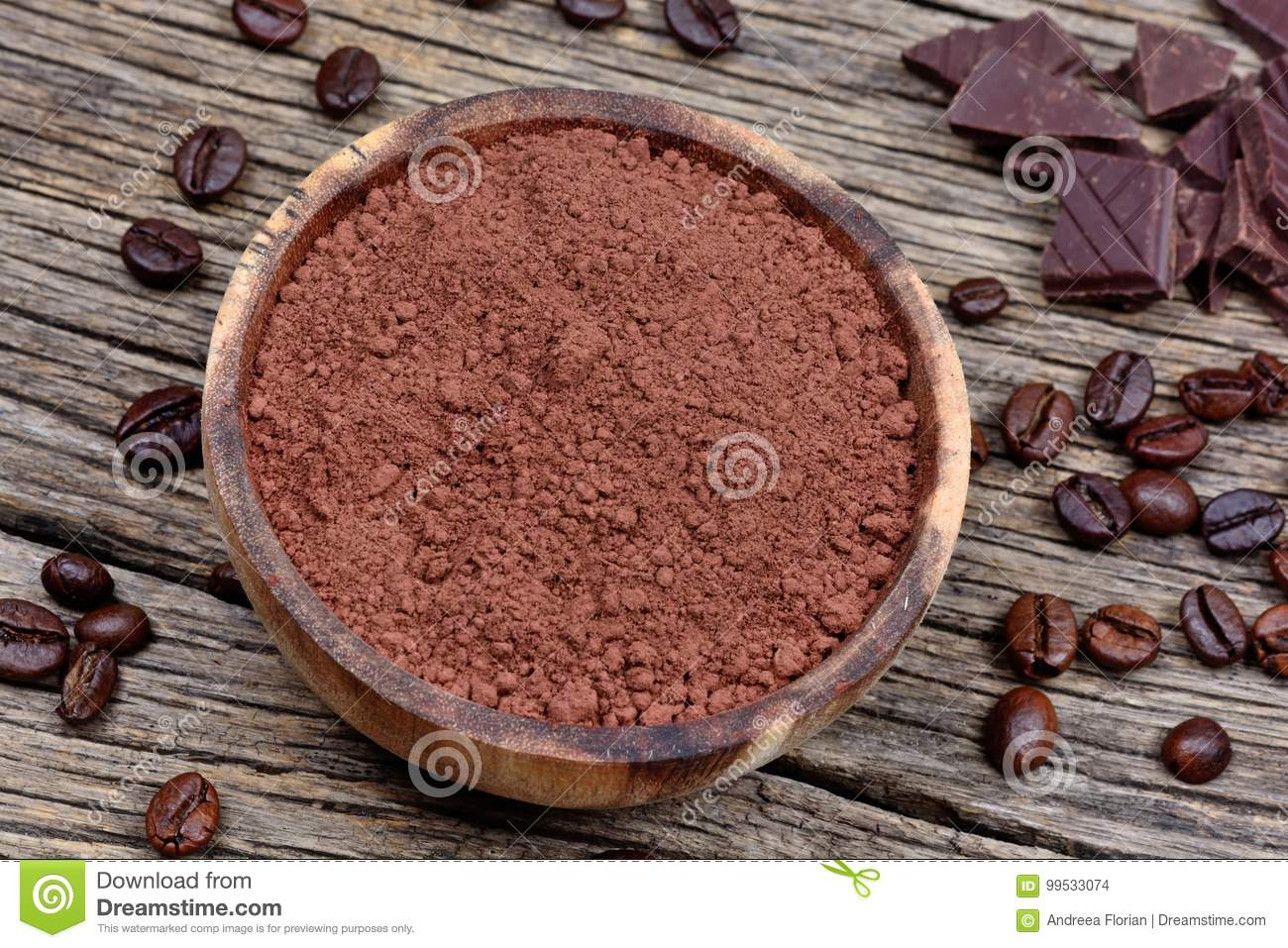 Bowl with cacao powder and coffee beans on rustic table