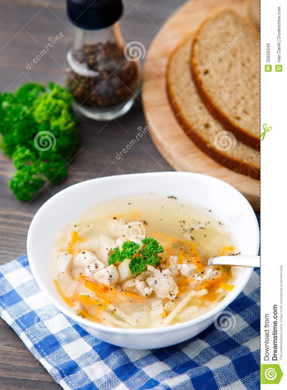 Bowl of chicken soup with vegetables and noodles stock for What vegetables to put in chicken noodle soup
