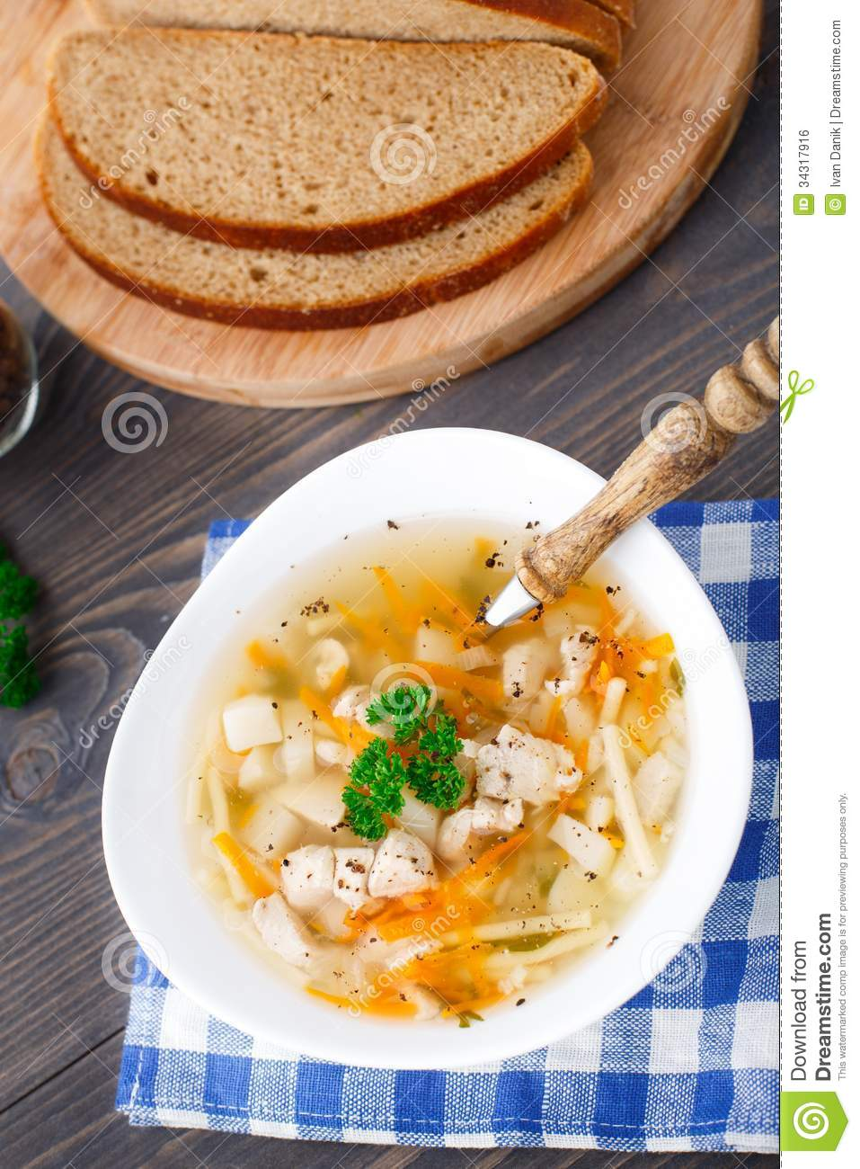 Bowl of chicken soup with vegetables and noodles royalty for What vegetables to put in chicken noodle soup