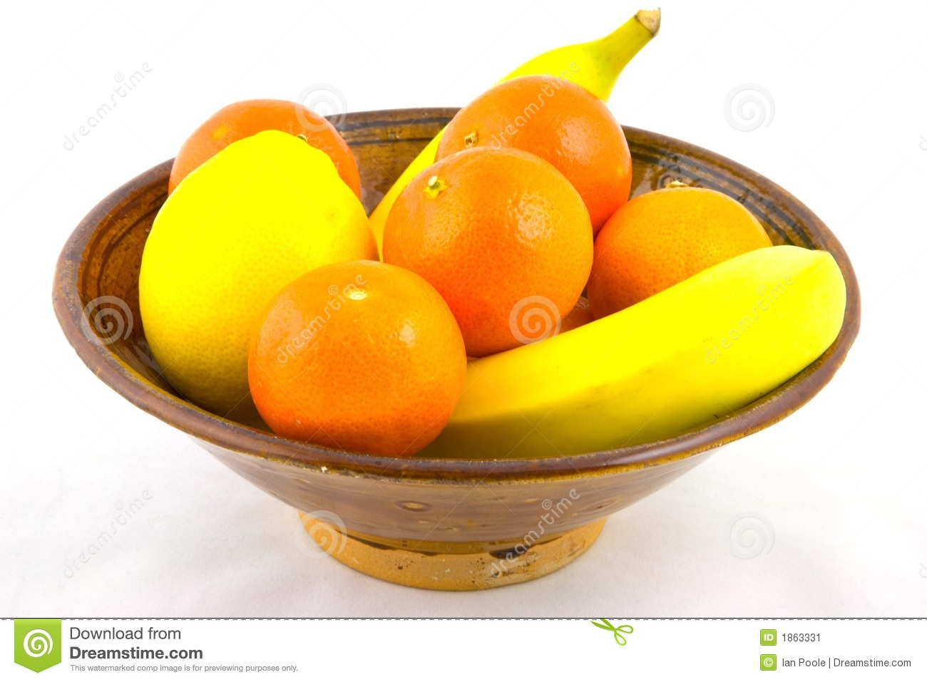 bowl of fruit containing oranges, bananas and a lemon.
