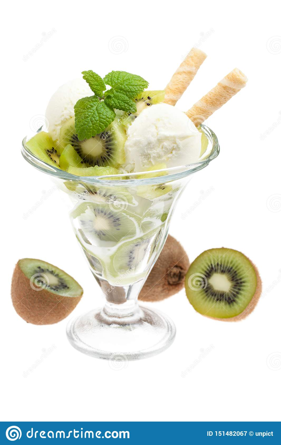 A bowl of kiwi ice cream with kiwis and cones isolated on white background with waffles