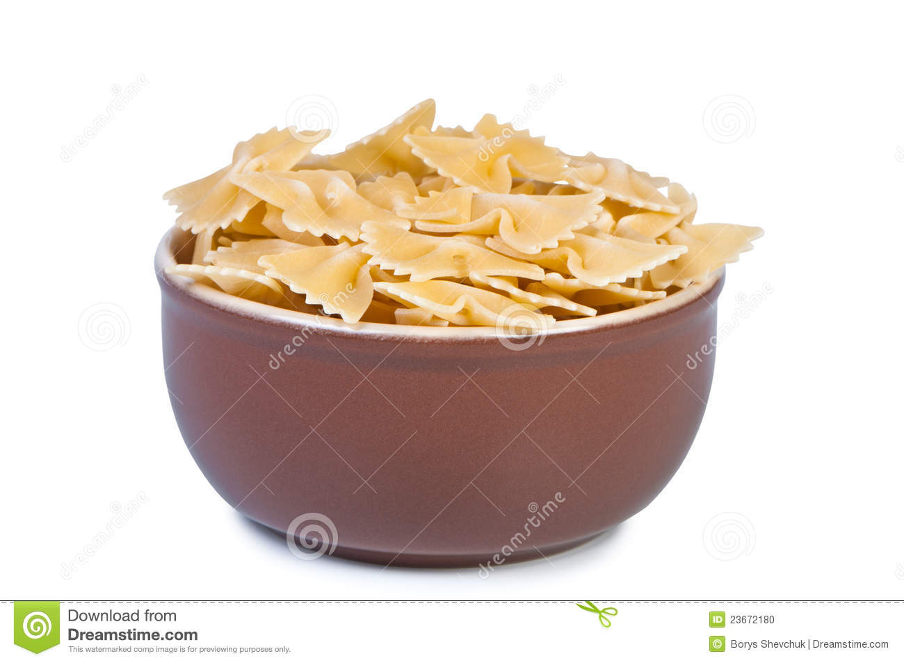 Bowl with raw pasta on white background.