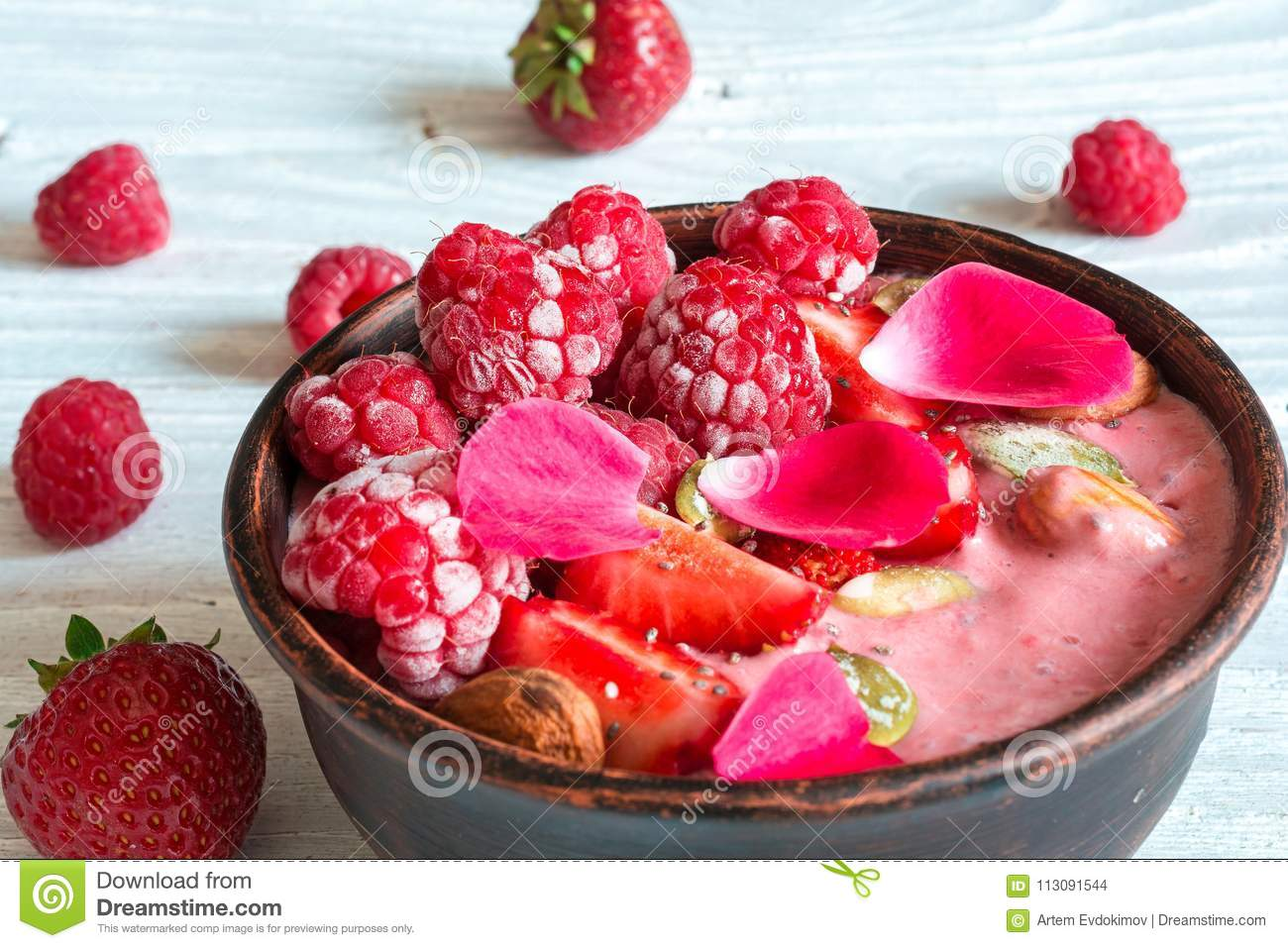 Bowl Of Red Berry Smoothie With Strawberry Raspberry Nuts And