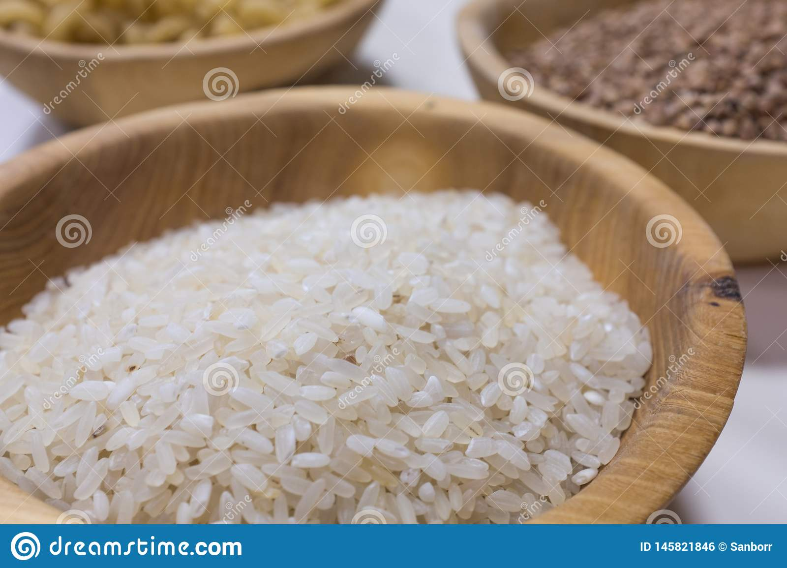 Bowl with rice on white background. Natural food high in protein