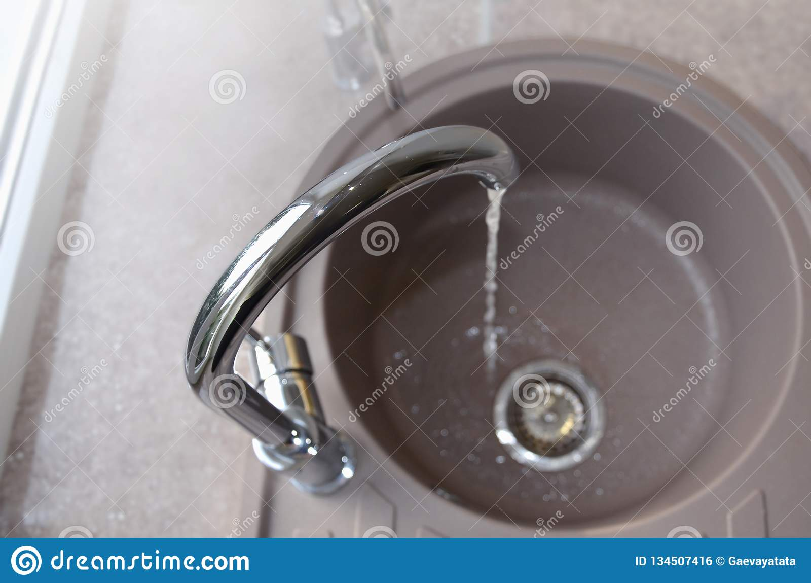 Kitchen Sink And Running Water, View From Above Stock Photo - Image on kitchen faucet, toilet drain, bathtub drain, wig hair catcher drain, kitchen drain parts, kitchen bench drain, kitchen clean out drain, chemical drain clog main drain, bathroom drain, kitchen bath drain, plumbing drain, kitchen drain assembly, kitchen sinks black finish, shower drain, kitchen bathroom, urinal drain, kitchen plumbing,
