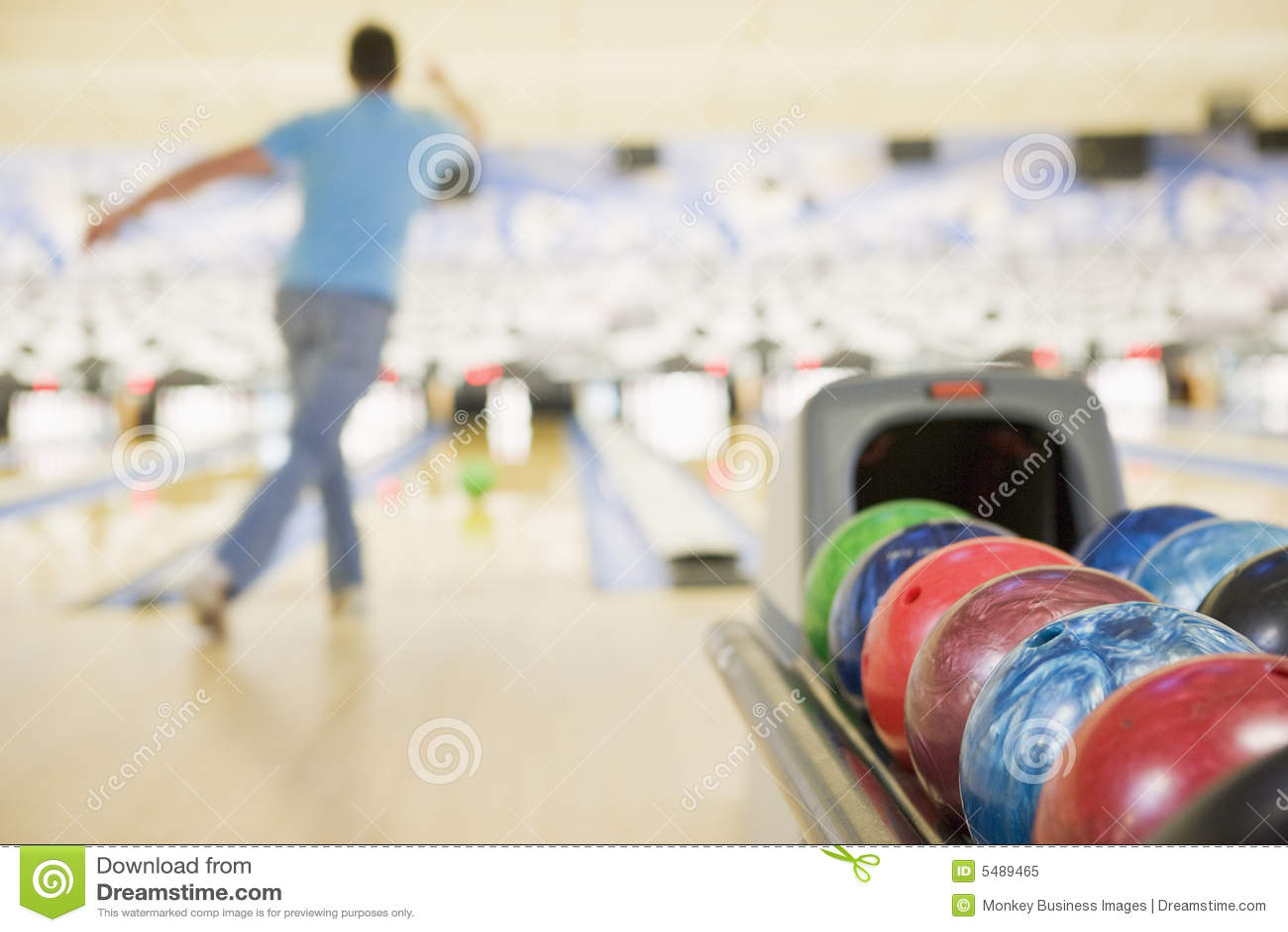 Bowling ball machine with man bowling