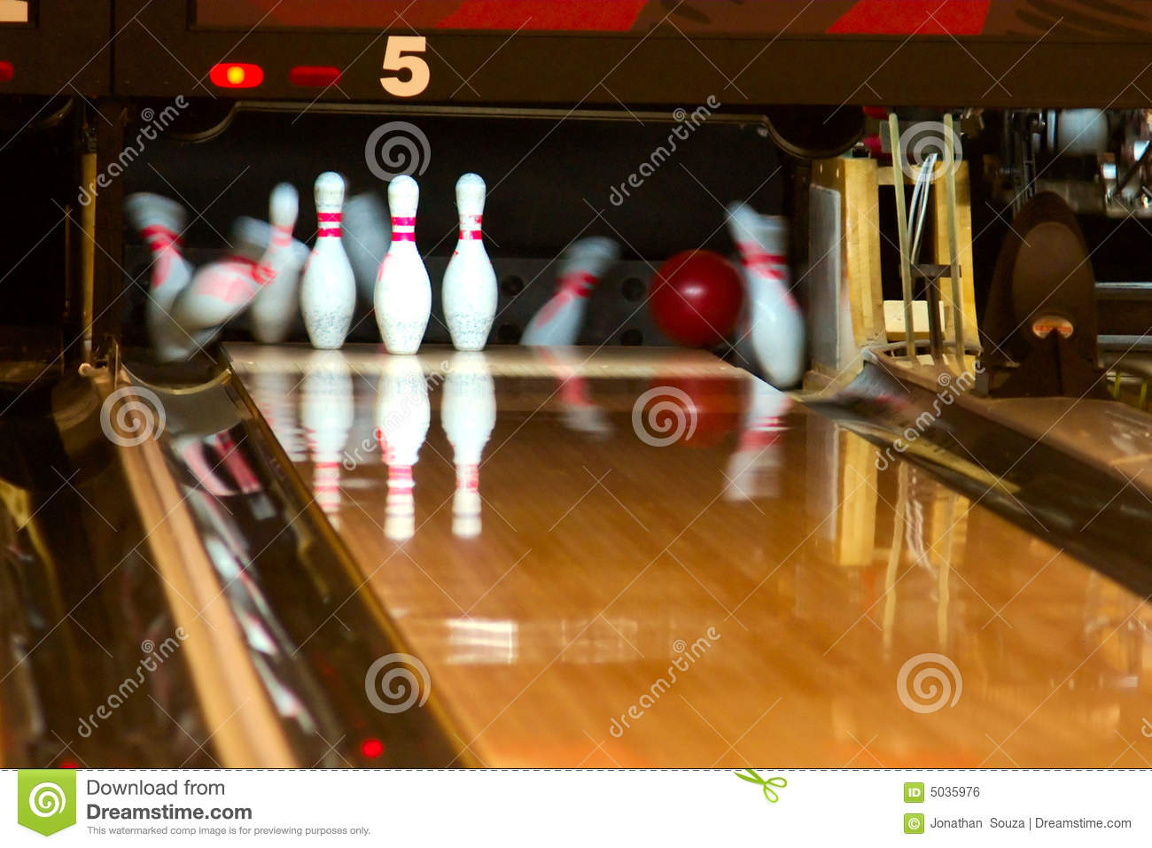 Bowling pins falling from ball