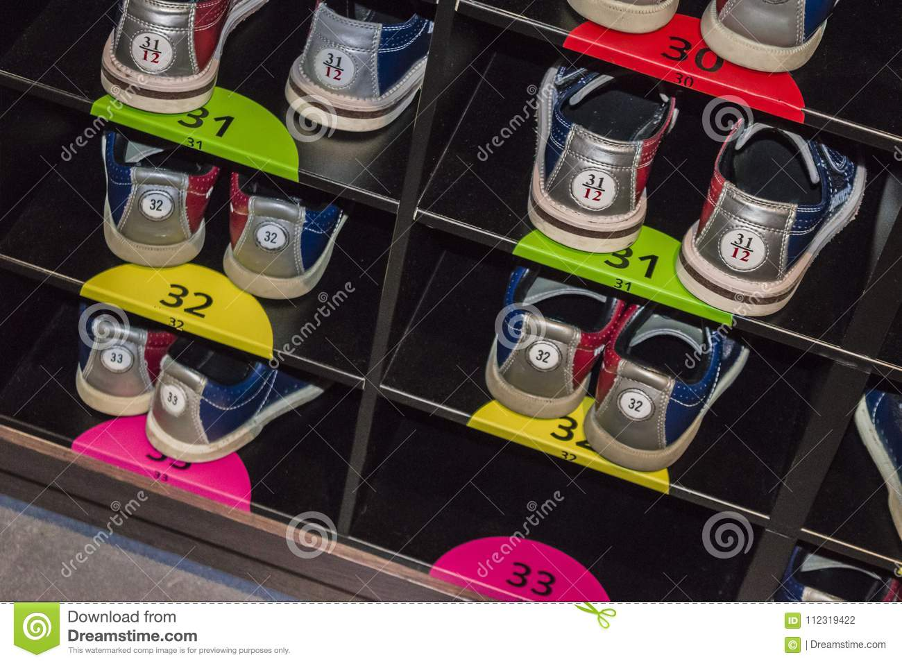 Bowling shoes in a shoe rack