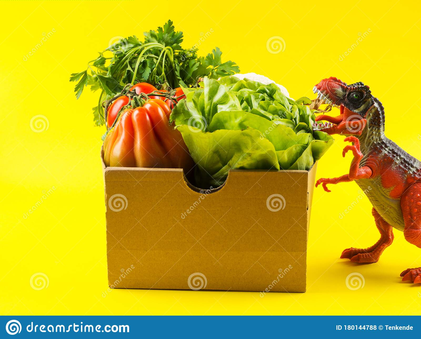 Box With Fresh Produce And Angry Dinosaur Stock Photo ...