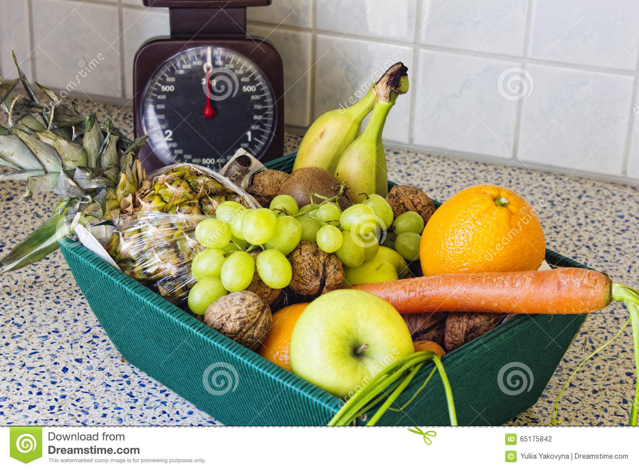 box of fruit and vegetables on the kitchen table. stock photo