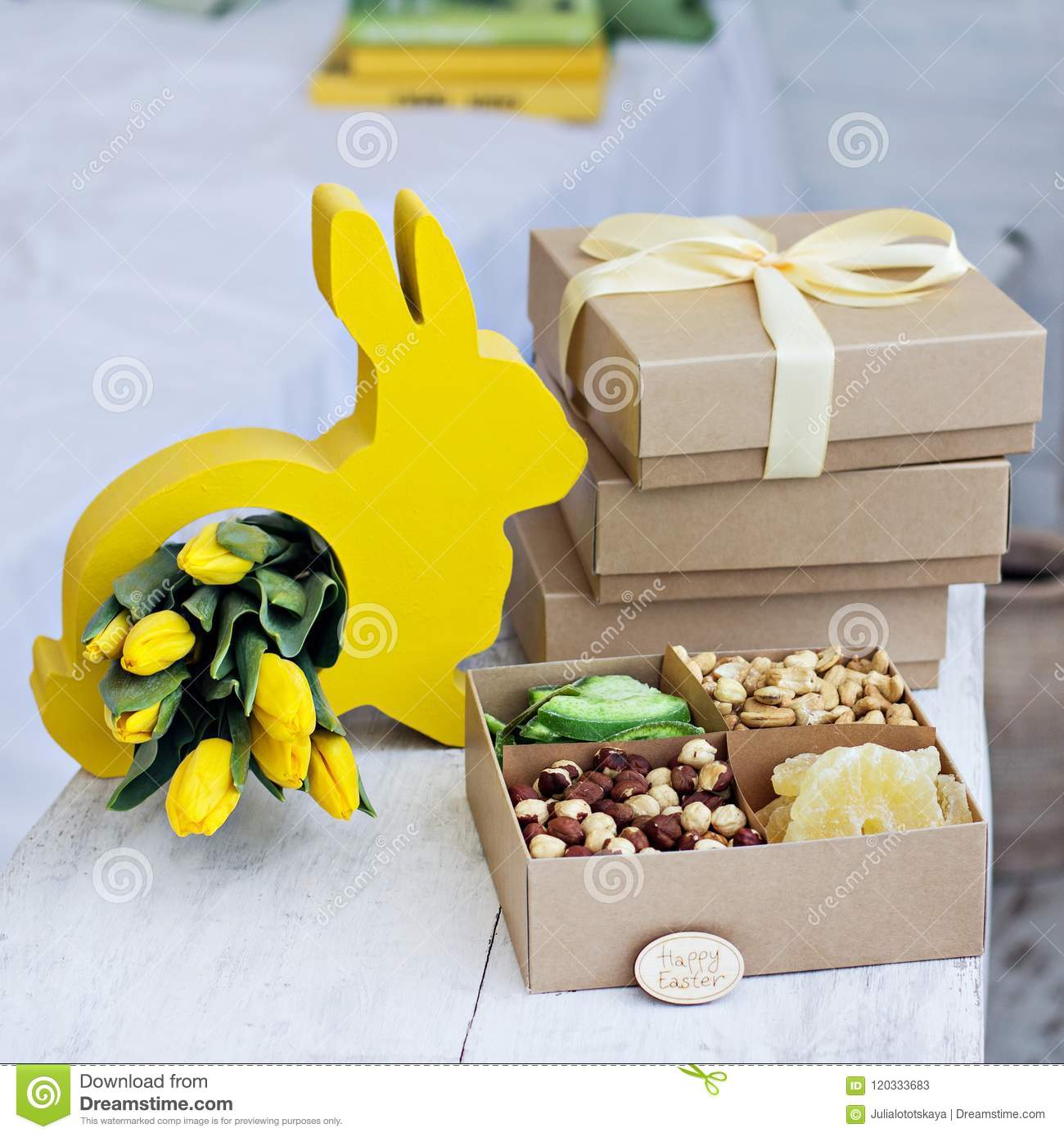 305d6183df03d Box With Nuts And Dried Fruits. Easter Table. Yellow Easter Bunny ...