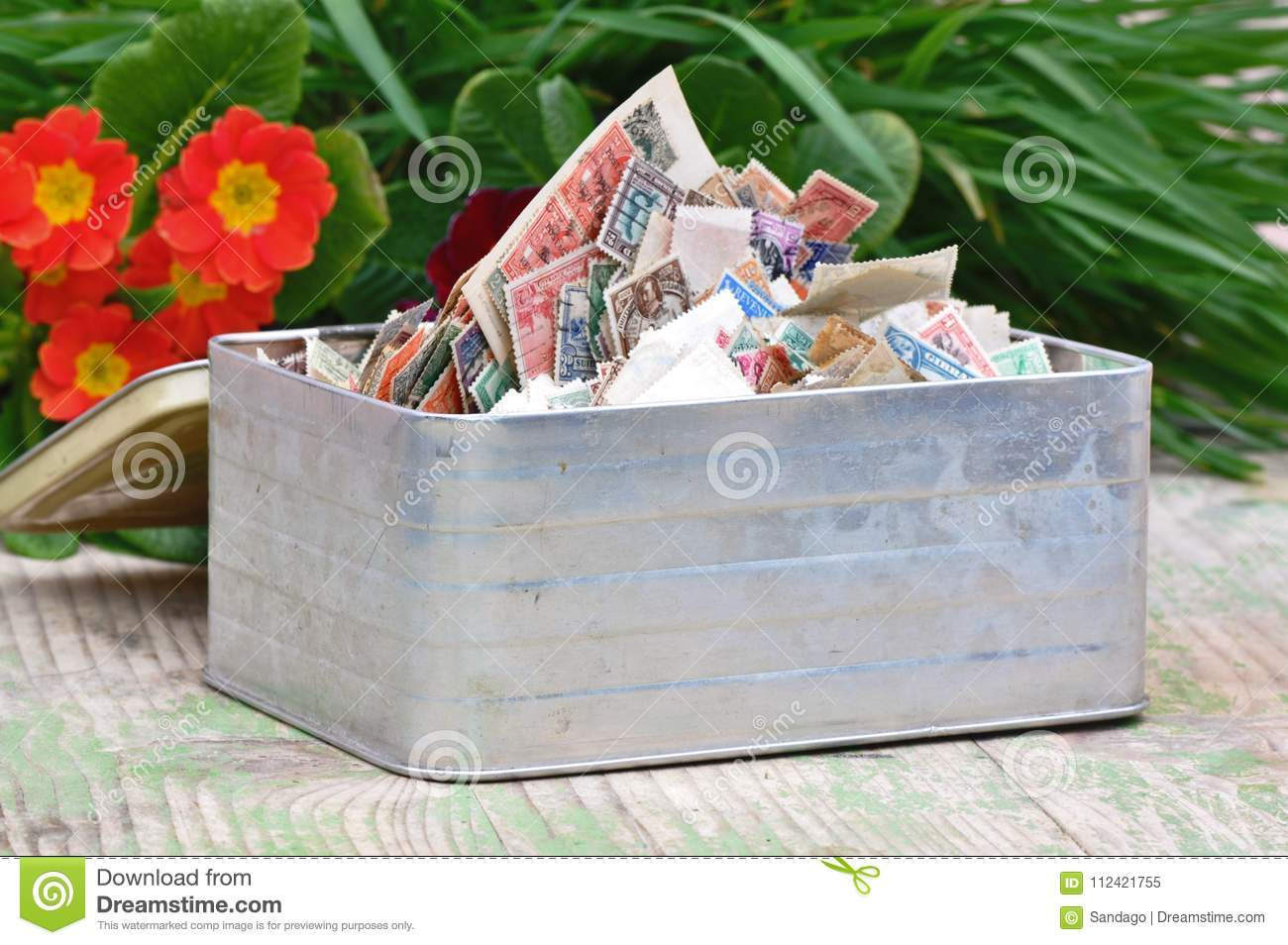 Box with pile of stamps