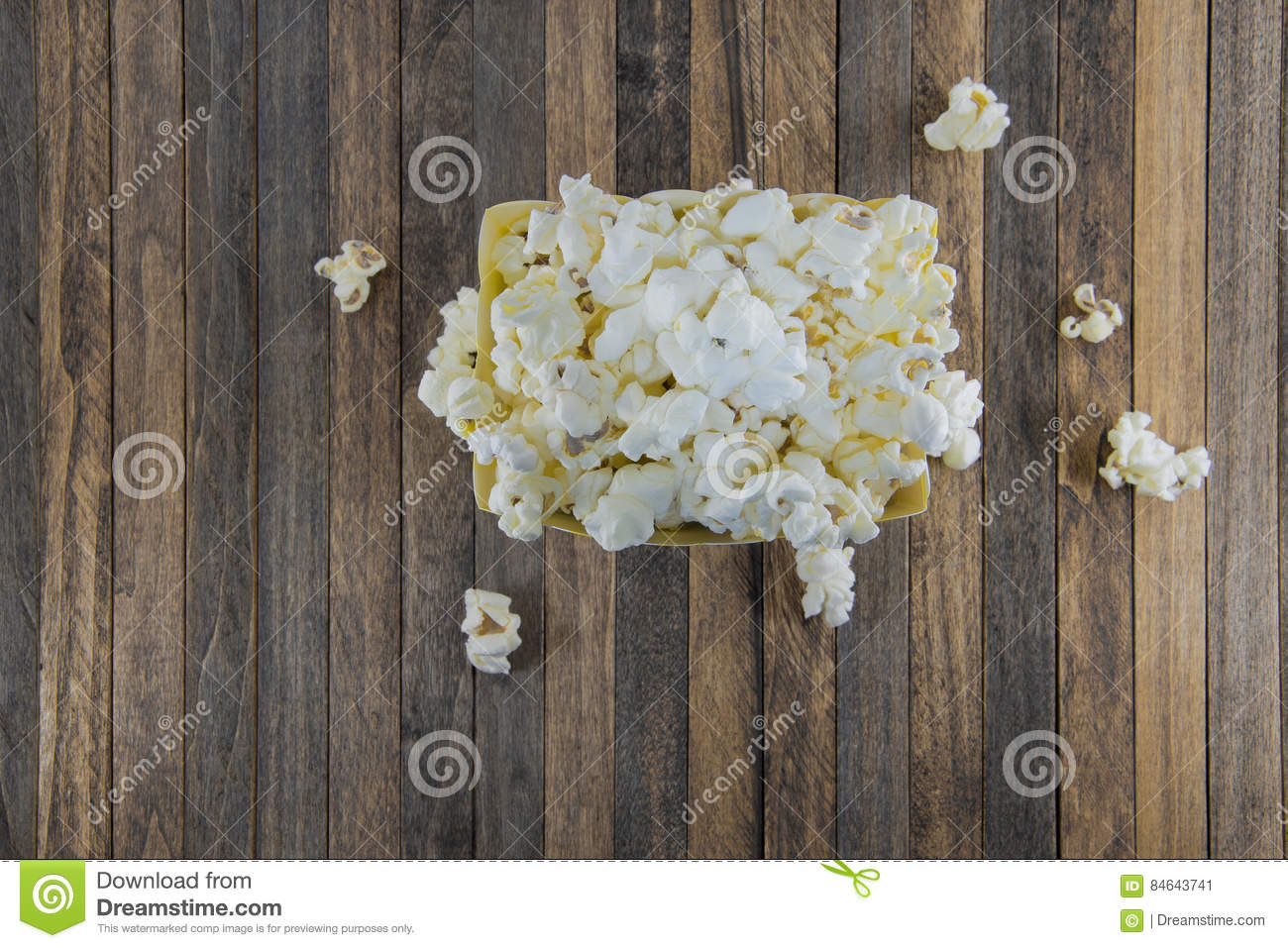 Box of popcorn on a wooden background