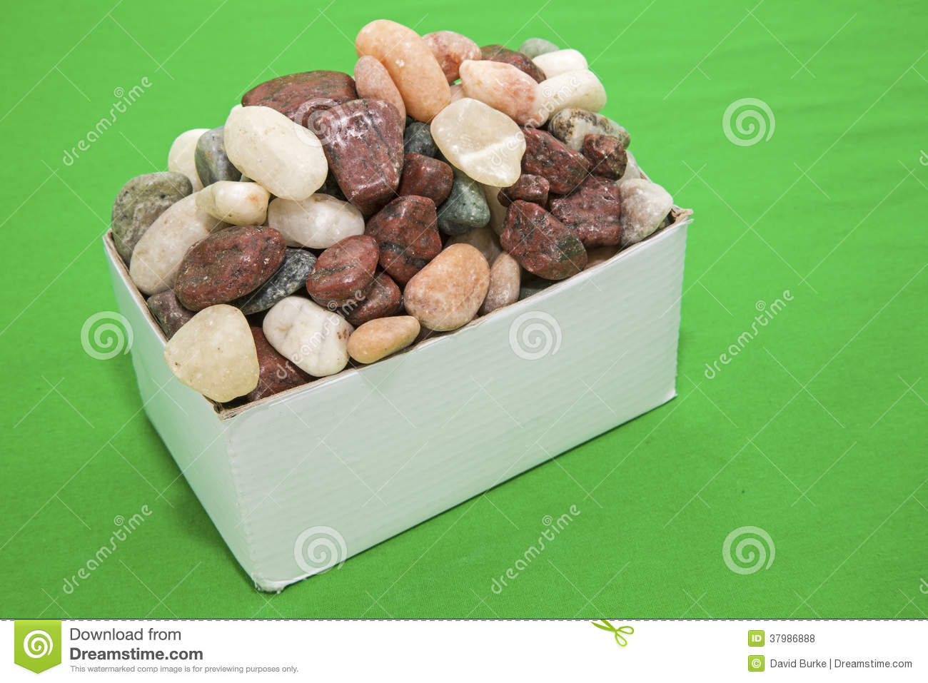 Box Of Rocks Green Background Royalty Free Stock Photos