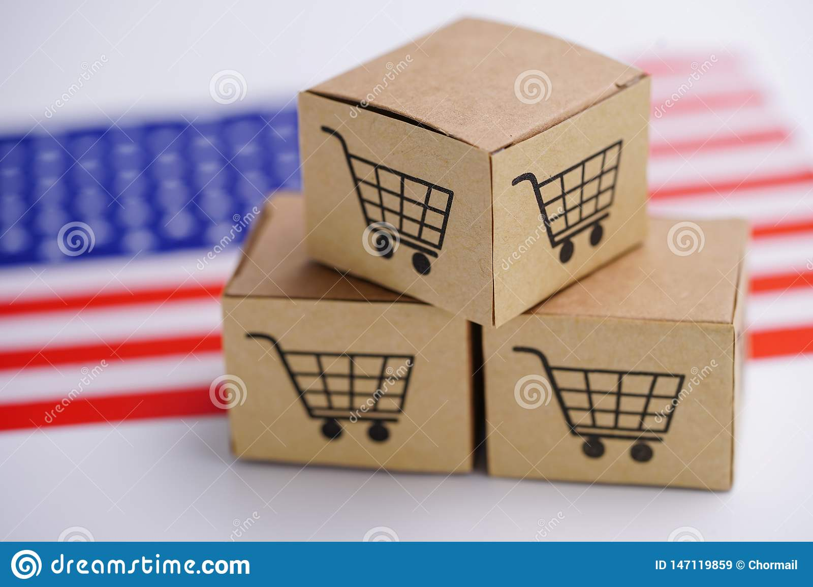 Box with shopping cart logo and United State of America USA flag : Import Export Shopping online or eCommerce