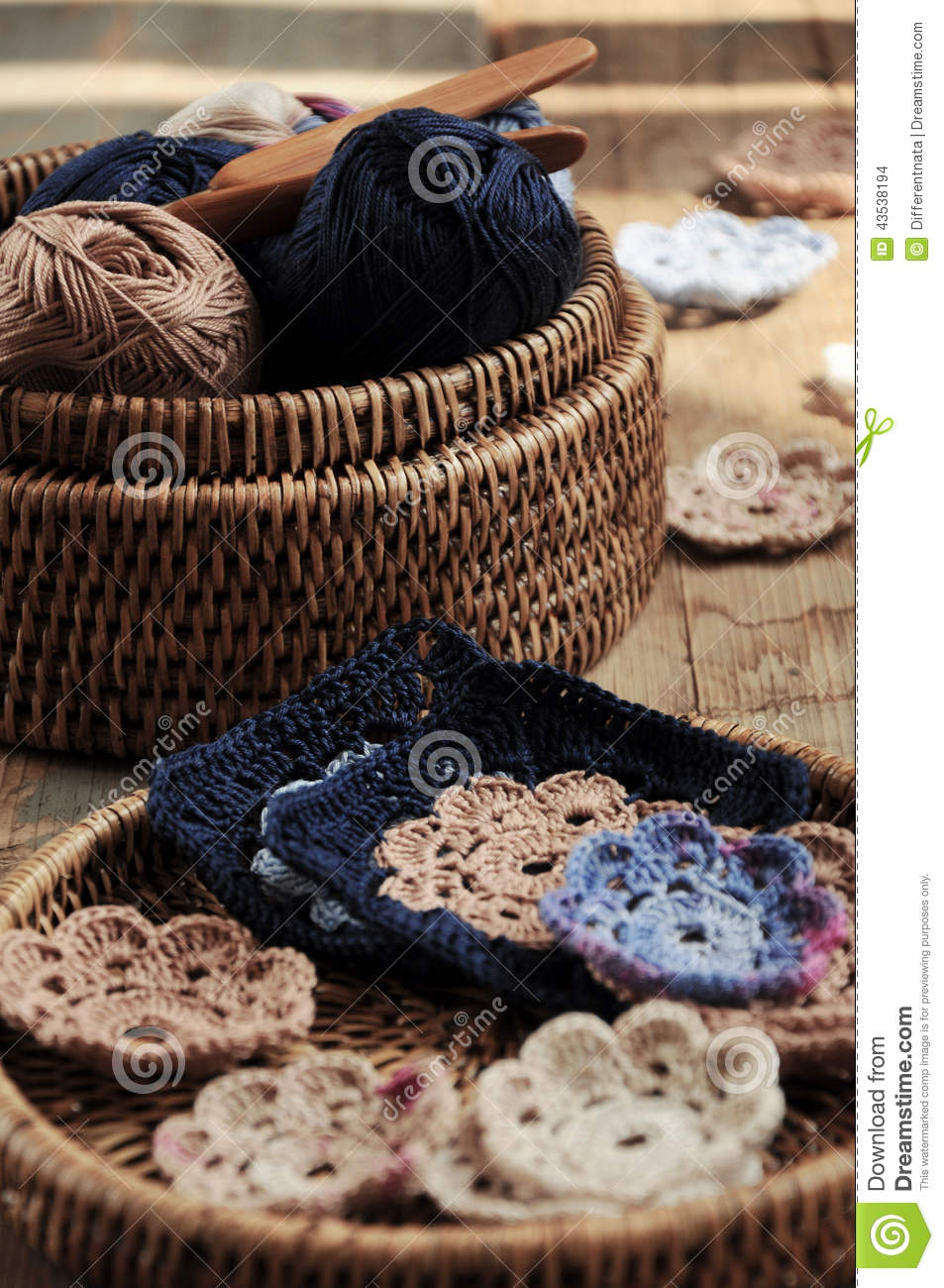 Box of yarn and crocheted flowers
