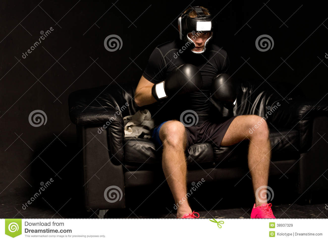 Boxer Sitting On A Couch Getting Ready For A Fight Stock