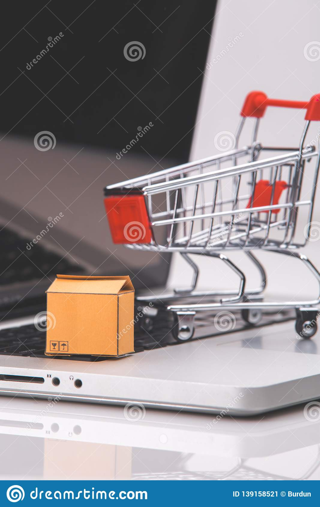 Boxes in and trolley on a laptop online shopping is a form of electronic commerce that allows consumers to directly buy