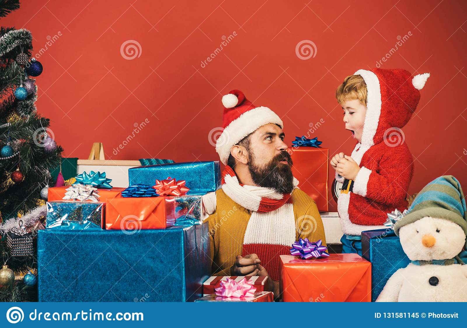 Boxing day and family concept. Santa and little assistant